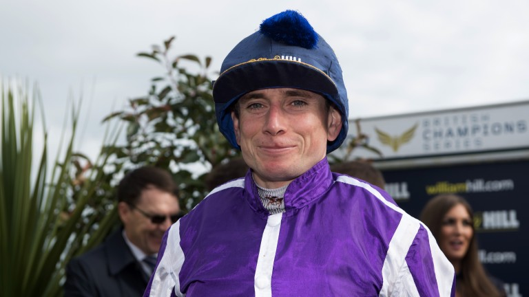 Proud moment: Ryan Moore dons the Leger Cap (and a grin) after winning the St Leger for the first time at Doncaster