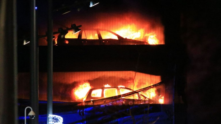 Vehicles burn during a blaze at a multi-storey car park at the Echo Arena on Liverpool's waterfront