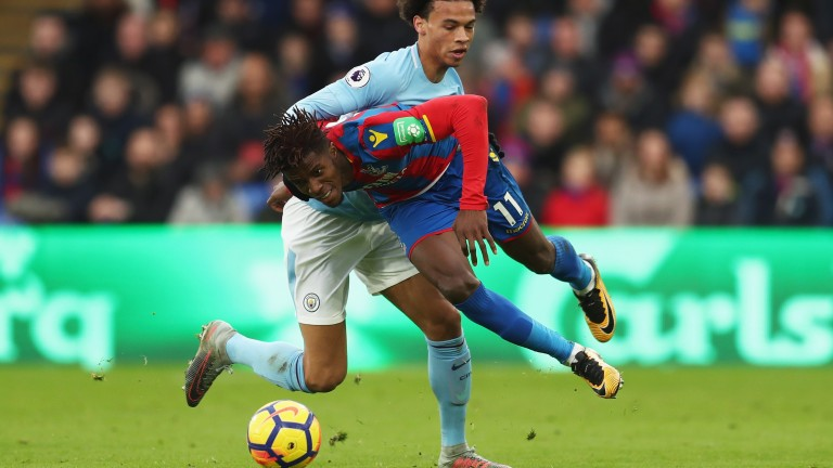 Wilfried Zaha with Leroy Sane during Crystal Palace's draw with Manchester City