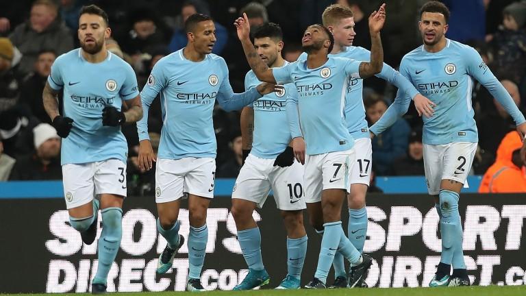 Manchester City celebrate Raheem Sterling's winning goal at Newcastle