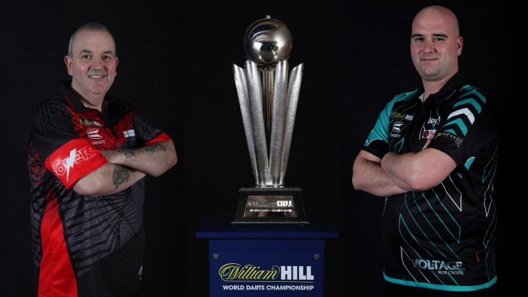 Ph8il Taylor and Rob Cross pose with the PDC World Darts Championship trophy