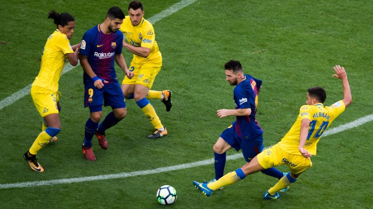 Las Palmas on the defensive against Barcelona's Lionel Messi