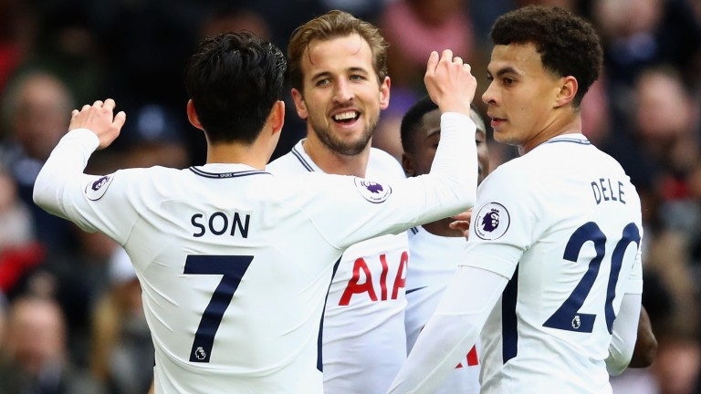 Harry Kane of Tottenham Hotspur celebrates with Heung-Min Son and Dele Alli