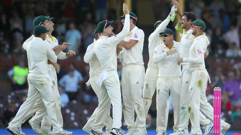 Australia celebrate the wicket of Joe Root in Sydney