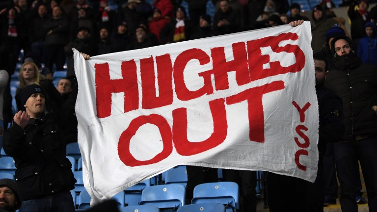 Stoke fans fly a 'Mark Hughes Out' banner