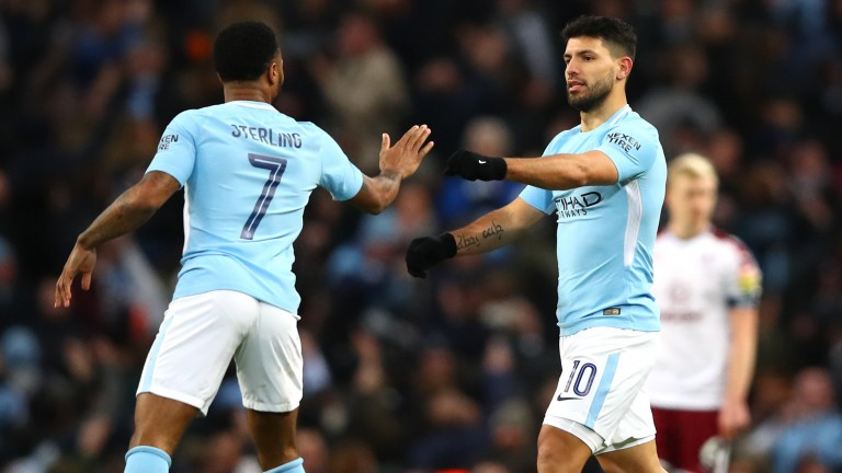 Sergio Aguero (number ten) celebrates with Raheem Sterling