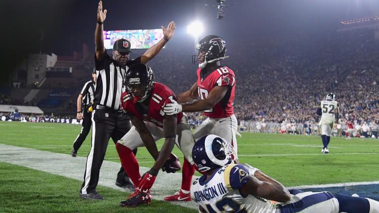 Atlanta's Julio Jones (11) scores a touchdown against the Rams