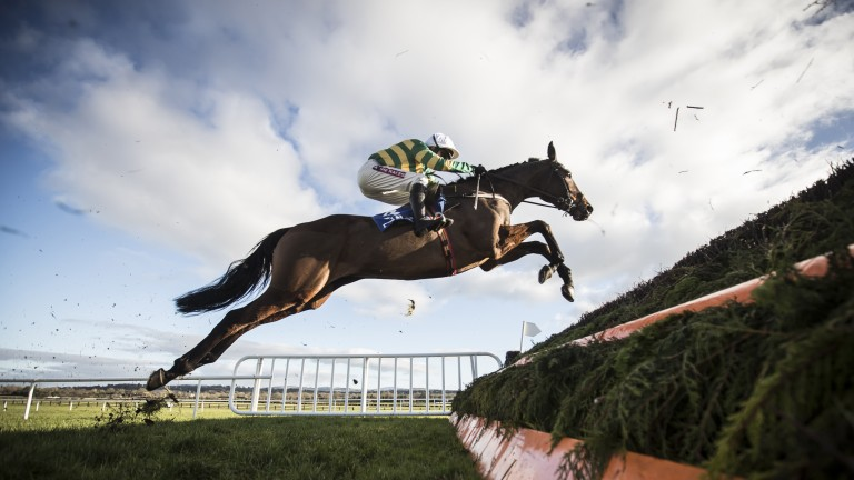 The JP McManus-owned Demi Sang puts in a big leap for Barry Geraghty on his debut for Willie Mullins at Naas on Sunday