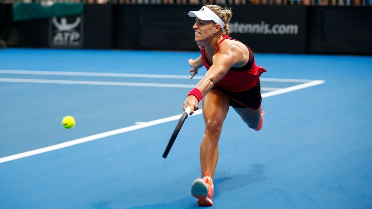 Angelique Kerber chases down a ball against Lucie Safarova