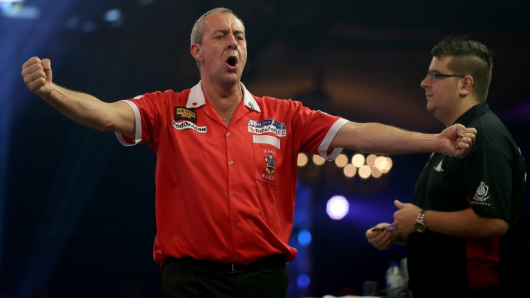 Wayne Warren enjoys his victory over Willem Mandigers at the Lakeside