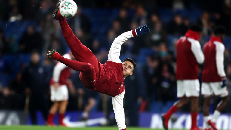 Alexis Sanchez does an overhead kick while warming up for Arsenal's recent clash with Chelsea