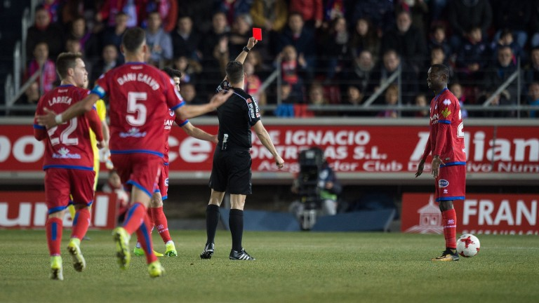 Numancia's Pape Diamanka gets a red card in the Copa del Rey match against Real Madrid