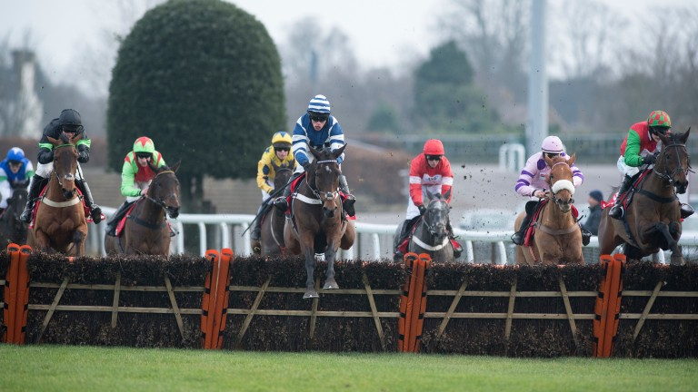 William Henry (centre, navy and white) produces a huge leap at the last before going on to win the Lanzarote Handicap Hurdle