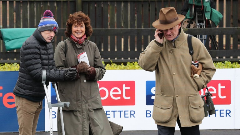 Willie Mullins passes on the news of Getabird's success as Ruby Walsh, on crutches, and Jackie Mullins look on