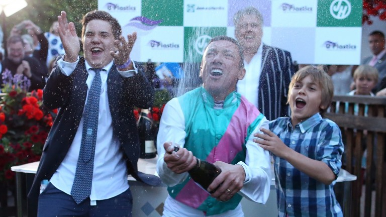 Dettori celebrates with his sons Leo (left) and Rocco after riding his 3000th winner on Predilection at Newmarket. His family has become an emotional anchor
