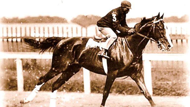 Top jockey Jimmy Winkfield wins a second consecutive Kentucky Derby on Alan-A-Dale