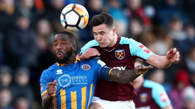 Shrewsbury's Abumere Ogogo (left) tussles with West Ham's Josh Cullen
