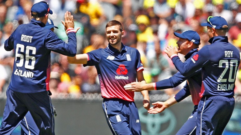 Mark Wood celebrates the early dismissal of Australia's David Warner in the first ODI