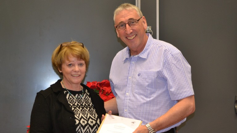 Mick Littlefair receives his diploma from TBA education and welfare manager Caroline Turnbull