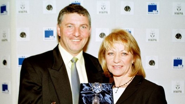 Anne Grossick with her husband John after being named horse racing photographer of the year in 2001