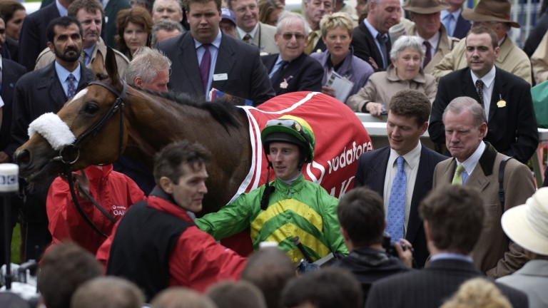 Serving at the president's pleasure: US ambassador to Britain Will Farish (right, yellow tie) after winning the 2003 Oaks at Epsom with Casual Look