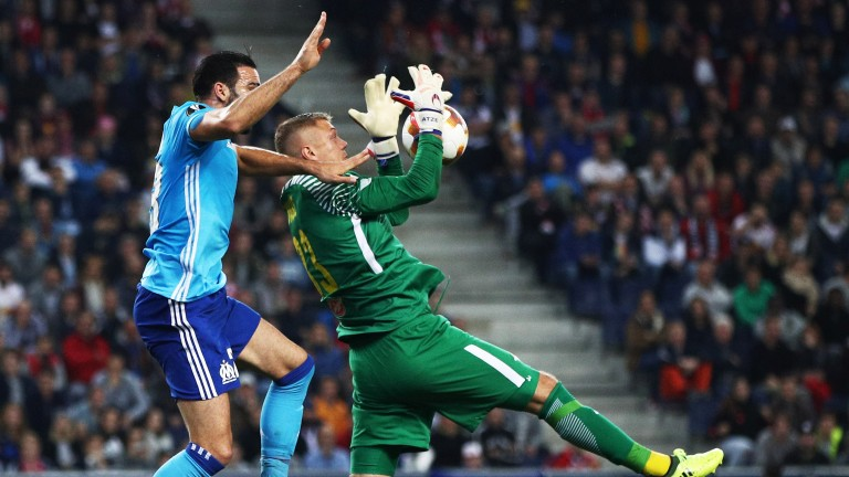 Marseille defender Adil Rami puts the Red Bull Salzburg keeper under pressure earlier this season