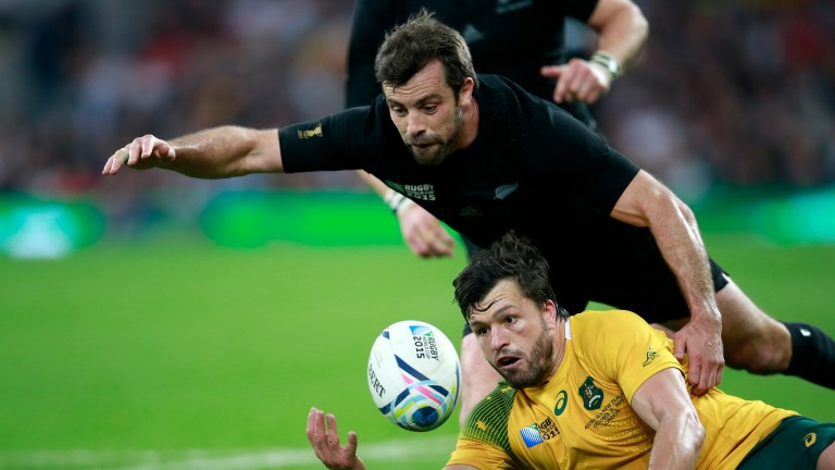 All Blacks centre Conrad Smith competes for the ball in the 2015 World Cup final