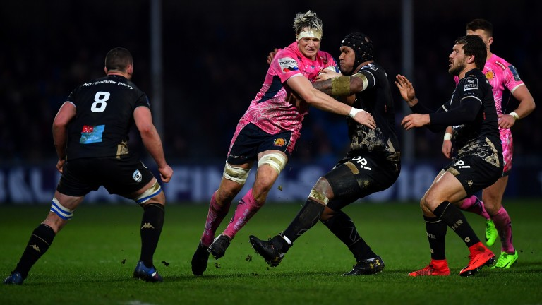 Exeter's Jonny Hill (pink shirt) punches a hole in Montpellier's defence