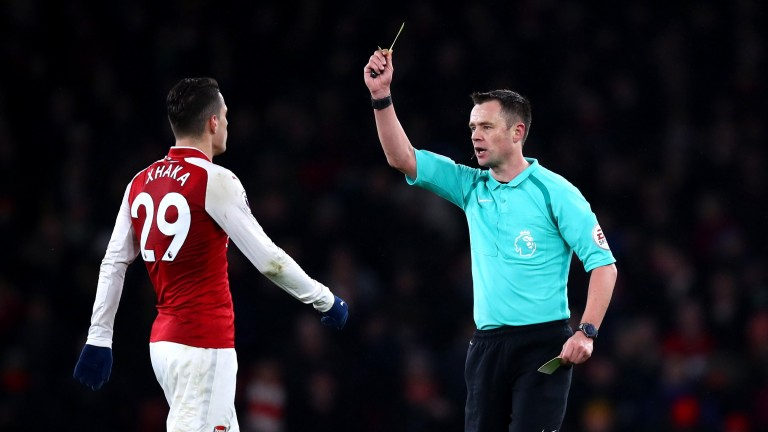 Arsenal's Granit Xhaka is shown a yellow card