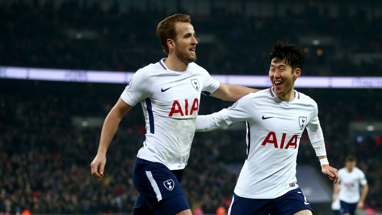 Harry Kane celebrates with teammate Heung-Min Son