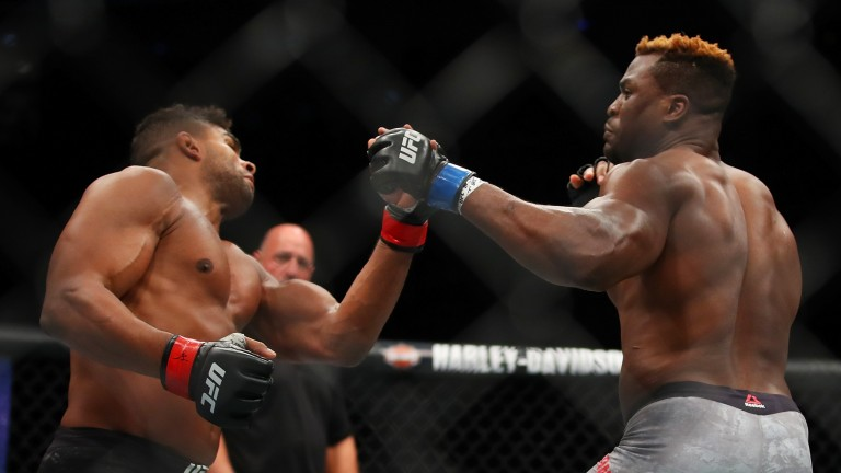 Francis Ngannou (right) battles Alistair Overeem during UFC 218