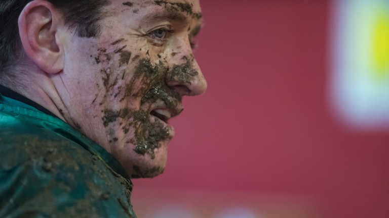 Tough work: Barry Geraghty's face is caked in mud after riding in the opener