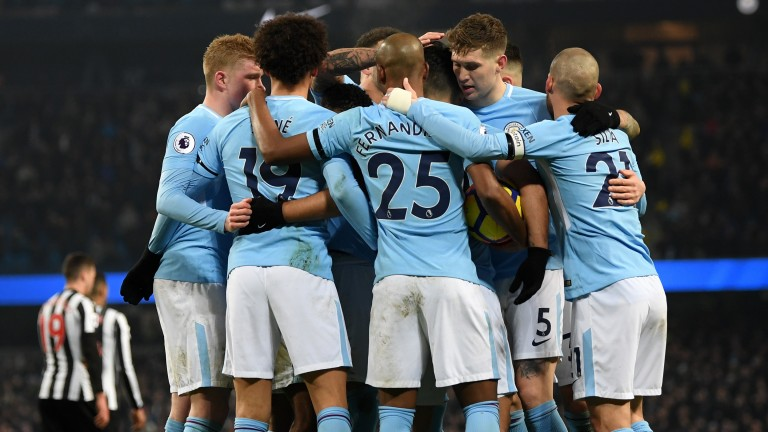 Premier League leaders Manchester City celebrate their win over Newcastle