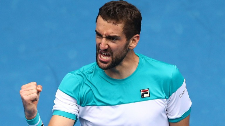 Marin Cilic celebrates his victory against Pablo Carreno Busta