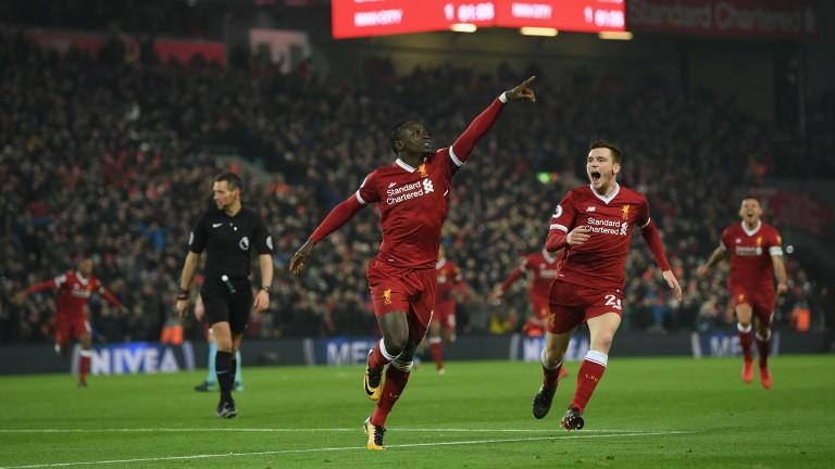 Sadio Mane celebrates with Liverpool teammate Andy Robertson