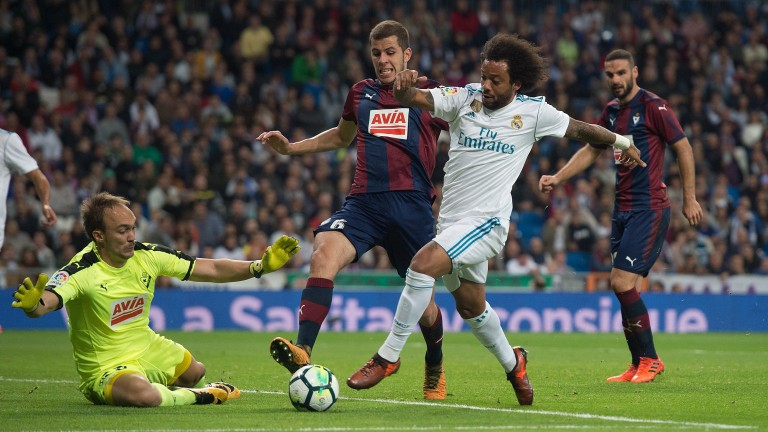 Marcelo of Real Madrid tries to shoot past Marko Dmitrovic of Eibar