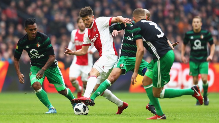 Feyenoord players attempt to take possession from Ajax's Klaas-Jan Huntelaar