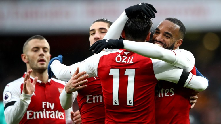 Alexandre Lacazette celebrates with Arsenal teammates against Crystal Palace