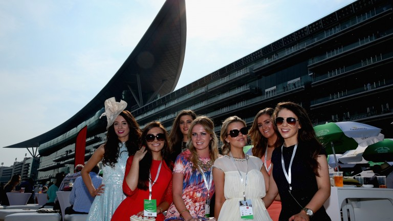 Racegoers enjoy the action at Meydan