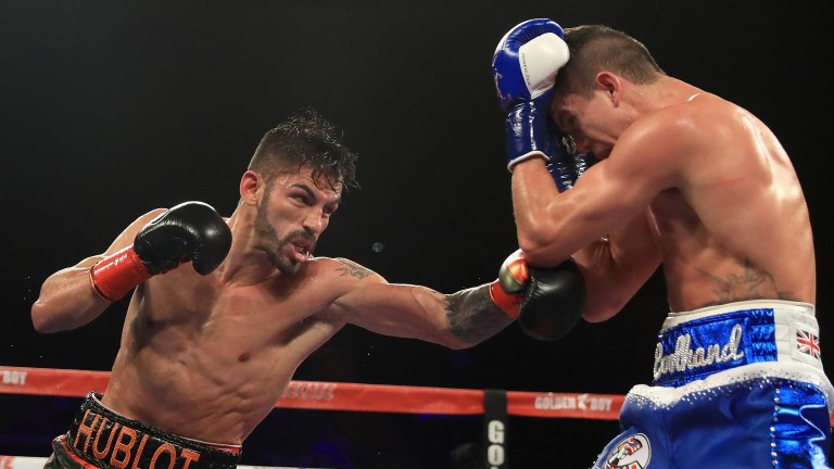 Jorge Linares (left) punches Luke Campbell