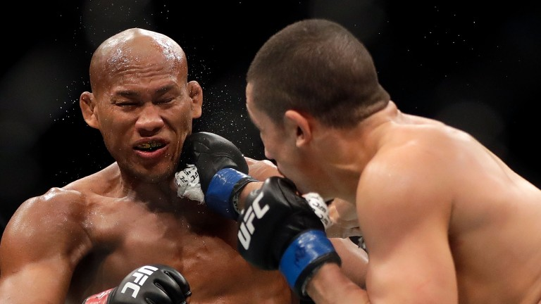 Jacare Souza (left) gets hit by a punch from Robert Whittaker