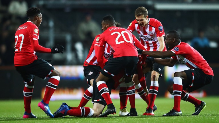 PSV celebrate a goal against Heracles