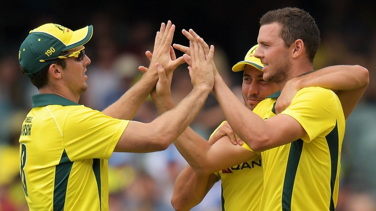 Australia's Josh Hazlewood (right) celebrates one of his early strikes in the fourth ODI in Adelaide
