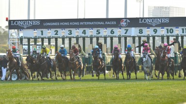 (5th from L) Zac Purton, jockey, and Time Warp leave the starting gate before winning The Longines Hong Kong Cup.