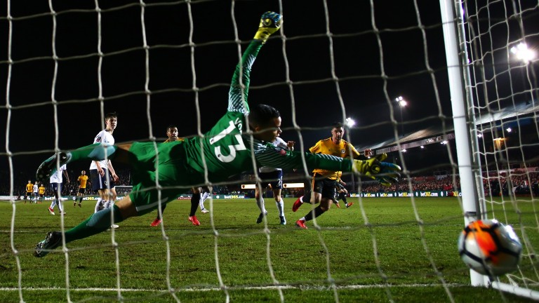 Padraig Amond scores for Newport County against Tottenham