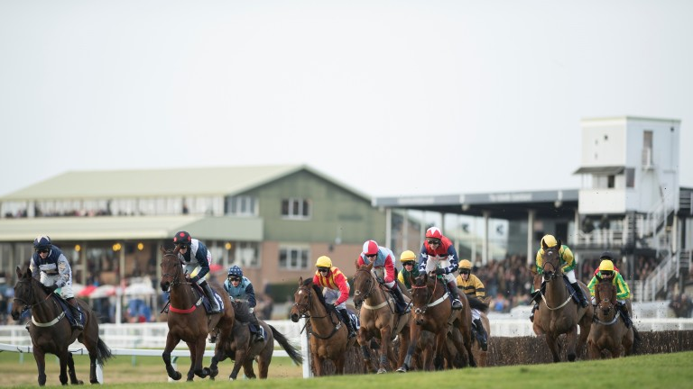 Runners swing away from the stands at Hereford, where there is an eight-race card on Monday