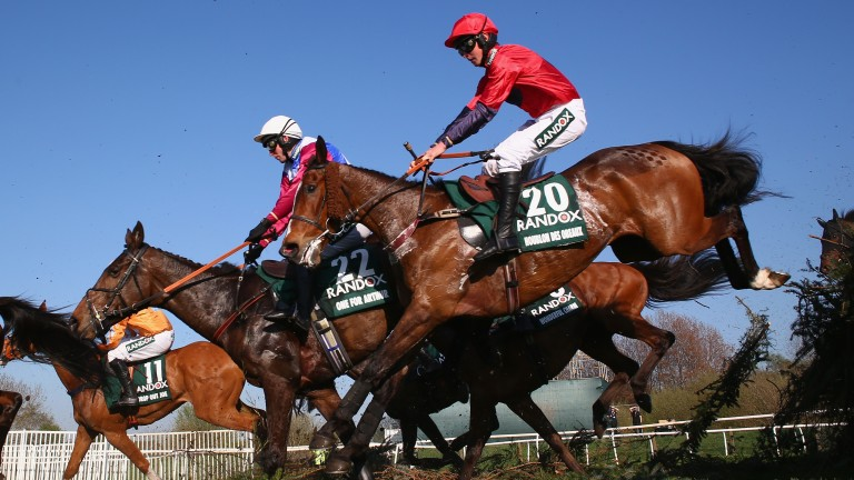 Houblon Des Obeaux (near side) jumps alongside winner One For Arthur during the Randox Health Grand National at Aintree last April