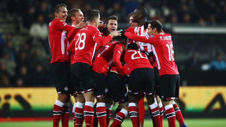 PSV celebrate after Davy Propper scores against Heracles