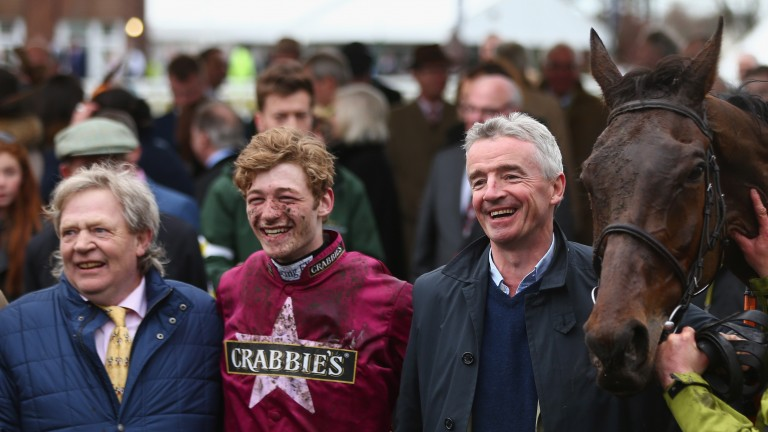 O'Leary with trainer Mouse Morris and jockey David Mullins after Rule The World's 2016 Grand National victory