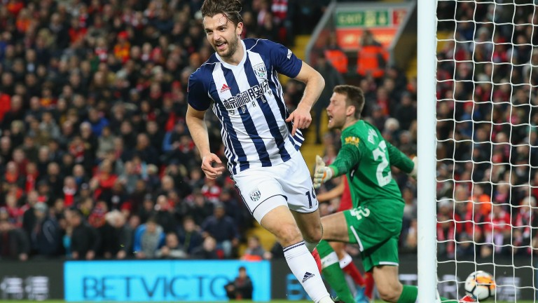 Jay Rodriguez wheels away after scoring in West Brom's 3-2 cup win at Anfield